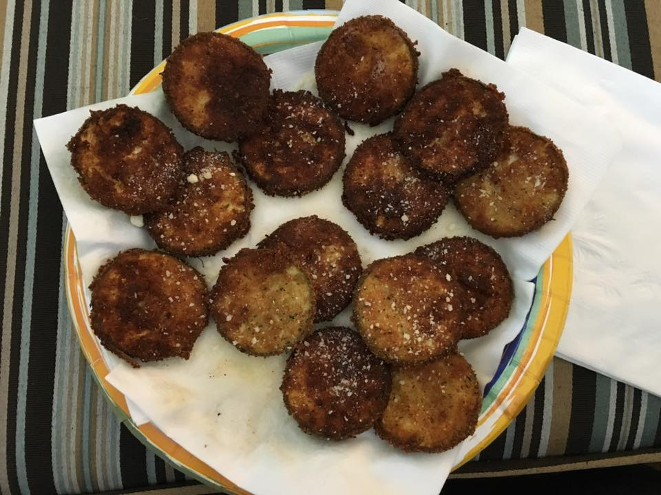 Sliced of zucchini, breaded and deep fried with Parmesan cheese sprinkled on top