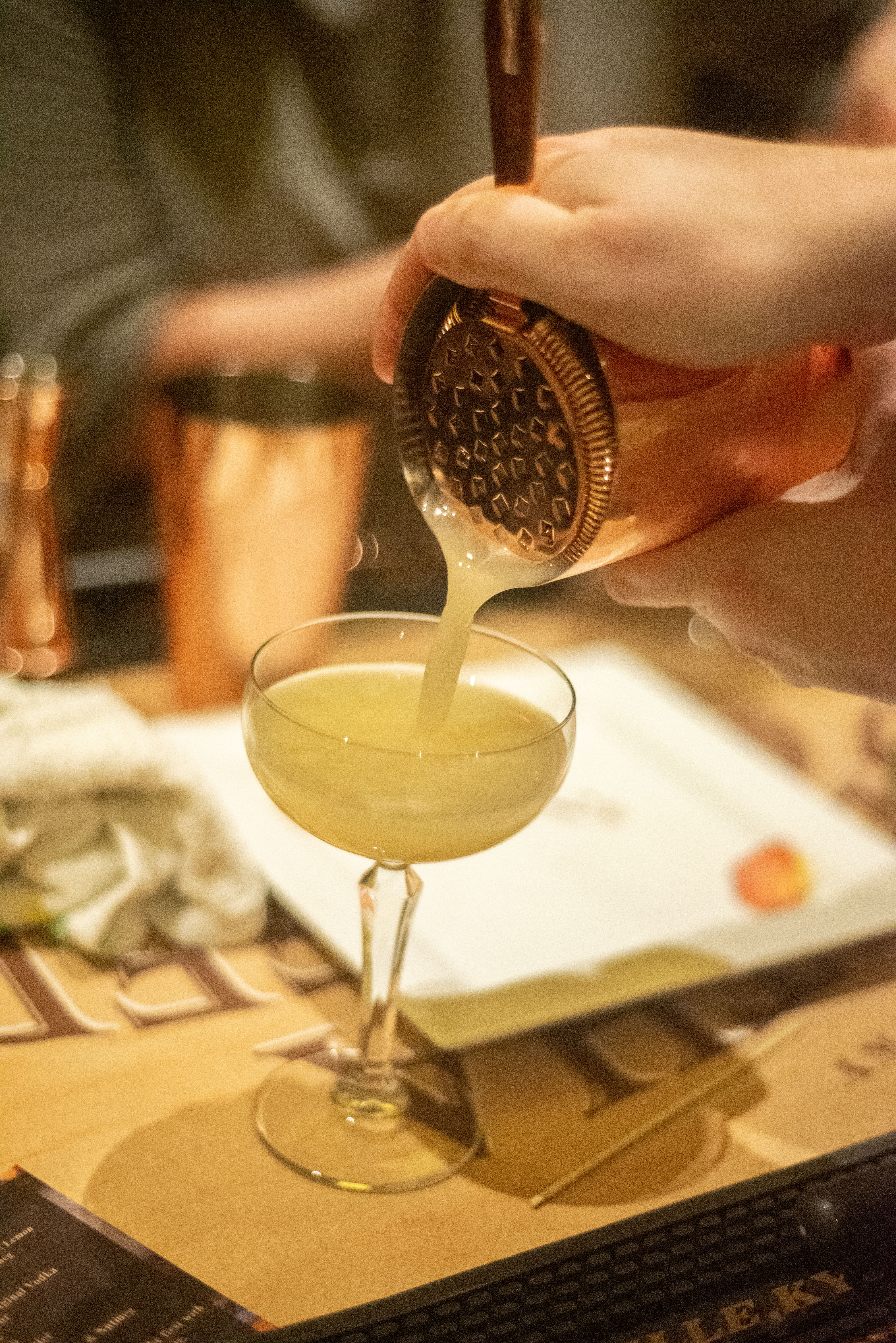 Drink being poured into a cocktail class
