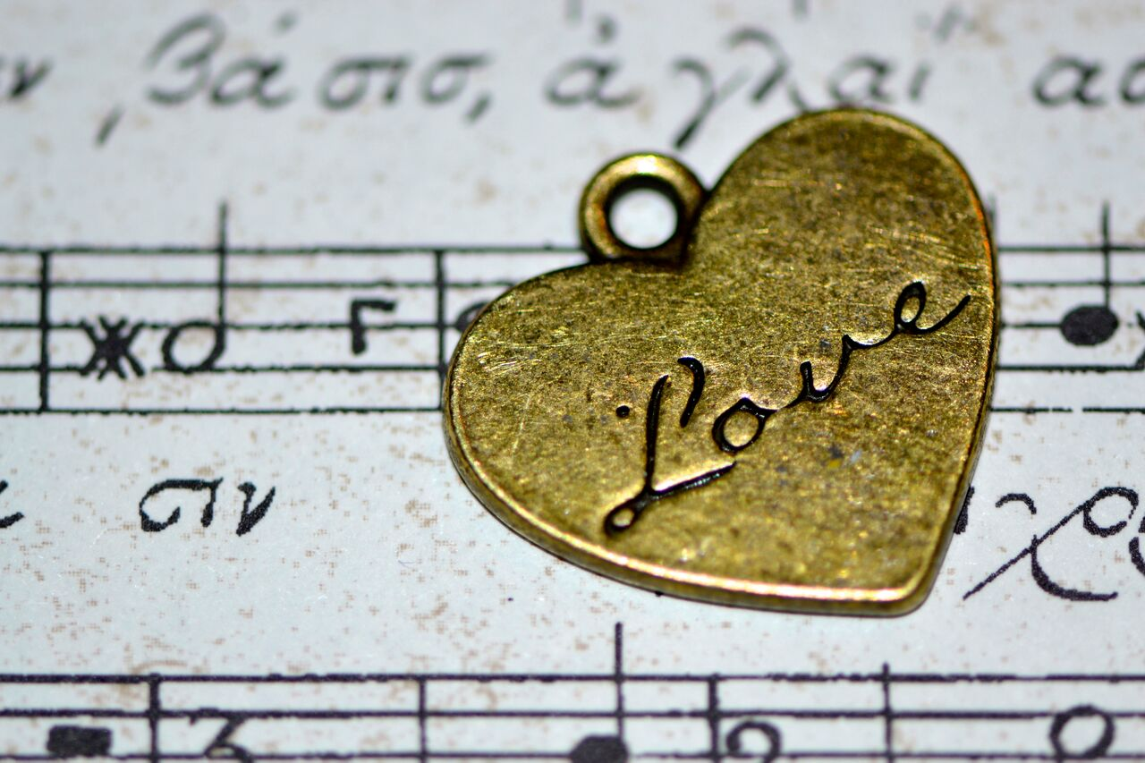 music notes with old heart and love