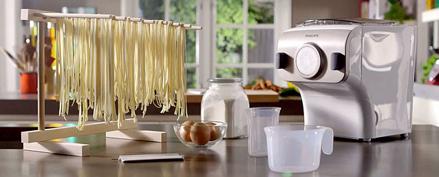Fresh spaghetti drying next to the Philips on a drying rack