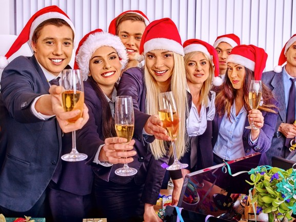 Happy business group people in santa hat at Xmas corporate party.