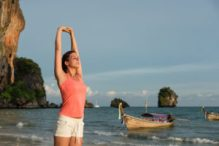 Sporty Woman Stretching Arms And Relaxing