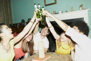Friends touching bottles in cheers celebration
