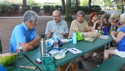 Members of Eastside Village eating at table