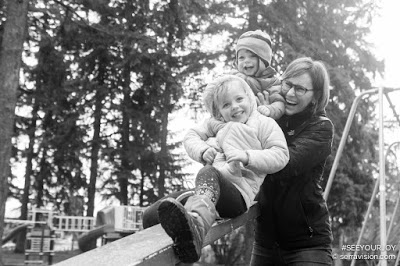 Child on Slide with Parents