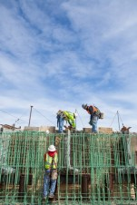Working together, workers tie rebar on a portion of the new bypass construction near Kearney Nebraska.