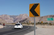 Sharing the Road Across Every Corner Mere miles from the iconic Las Vegas Strip, drivers and bicycliests converge on Nevada State route 149 to explore the desert scenery and natural red rock formations.
