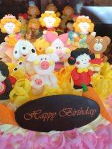 Birthday cake in window.