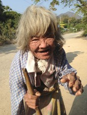 Met this woman (or man) on the street in the countryside. She wanted to hold our hands or for us to put coins in them. We weren't sure so did both. We called her Yoda's grandmother. Amazing face.