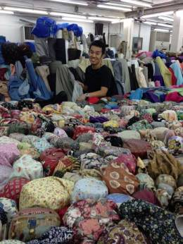picking out fabrics for the tailors