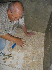 John working on the shower floor
