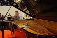 Chuan playing the world's largest production piano: the Fazioli concert grand measuring over 10 feet.