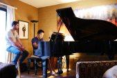 Karam and Chuan dueling at the piano