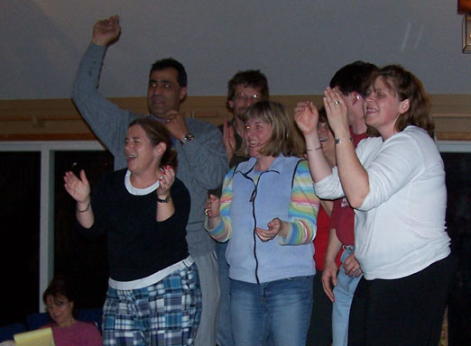 Photo of the group dancing, smiling and having fun