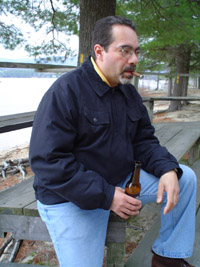 Photo of Jorge outside sitting on the picnic table