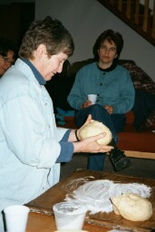 Photo of Sandi and Joanna kneeding dough.