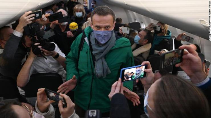 Alexei Navalny with journalists as he prepares to leave for Moscow from Berlin