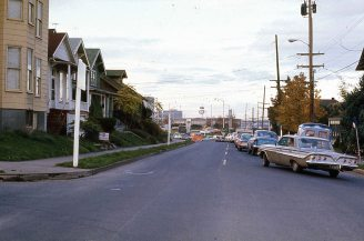 SW Kelly at Curry, Portland, OR. 1974. Line of traffic waits to cross the Ross Island Bridge.