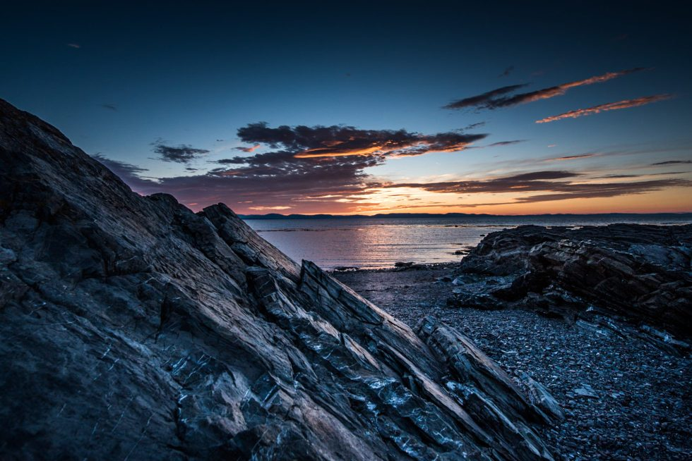 photo of a Canadian sunset with rocks and clouds