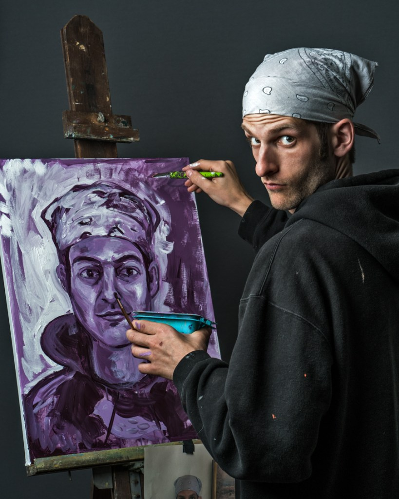 artist painting self-portrait