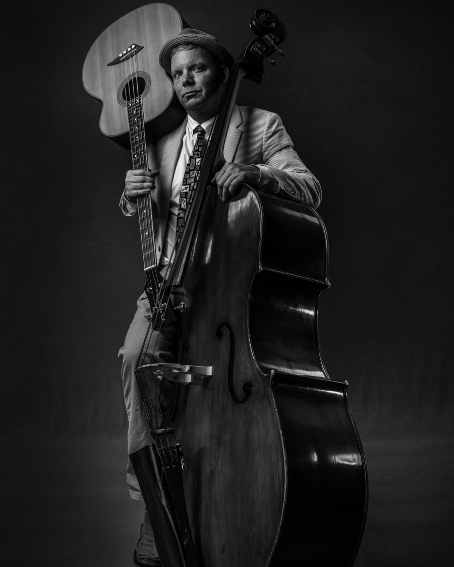 musician with bass and guitar
