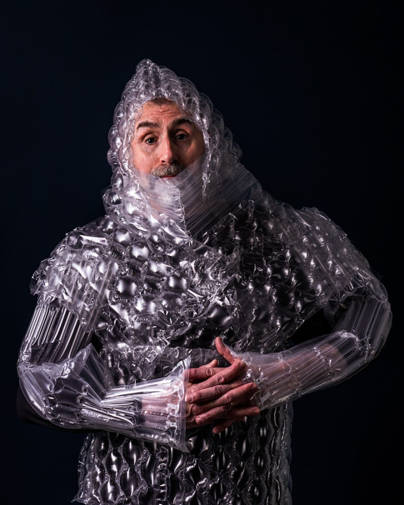 man wrapped in bubble wrap