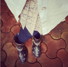 A floral pleated skirt worn with floral boots and navy stockings | Chai High is an Indian Fashion Blog started by Shivani Krishan