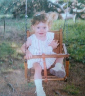 Baby me so very happy on my swing.
