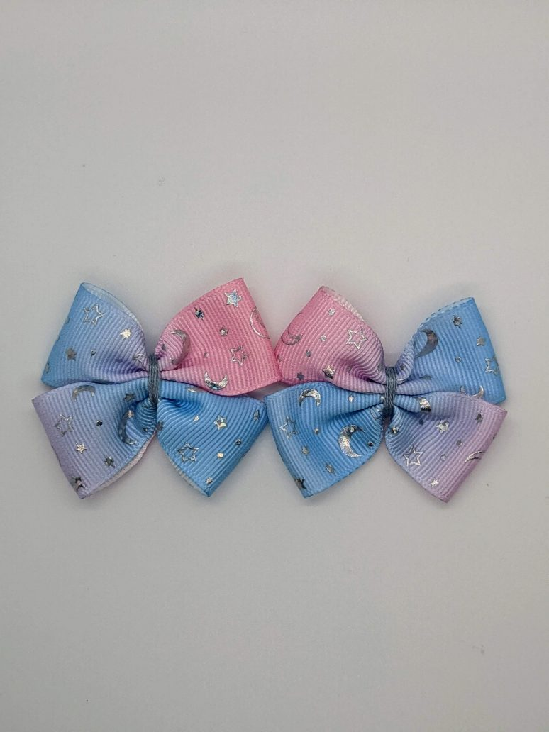 pink and blue gradient with silver foil stars and moon