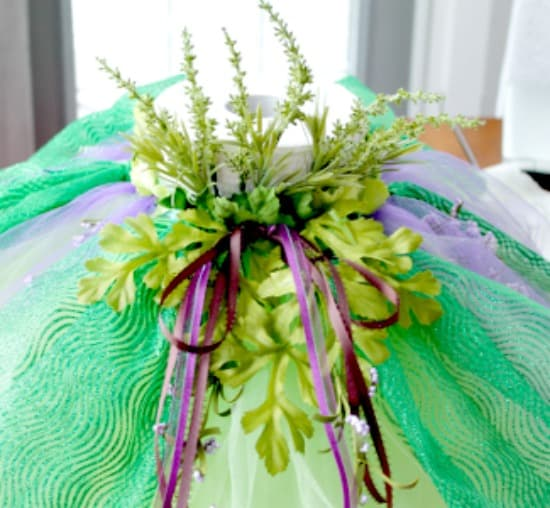 I designed this tutu to look like a bohemian bodice using leaves and flowers. This design uses a lots of greenery, leaves taken off of dollar store flowers can be used.