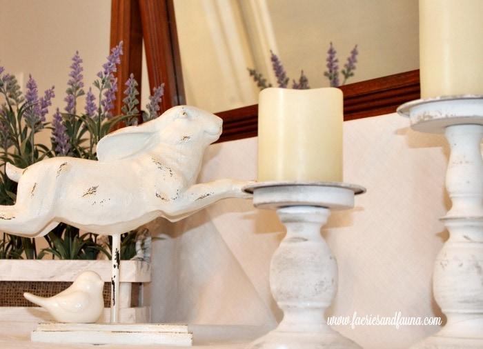 A white rabbit sitting on an antique dresser adds farmhouse charm. DIYwindow shelf, DIYwindow rod, DIYwindow treatment,