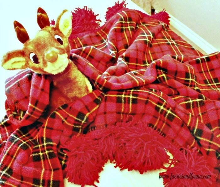 A handmade fleece blanket folded up and displayed for Christmas.