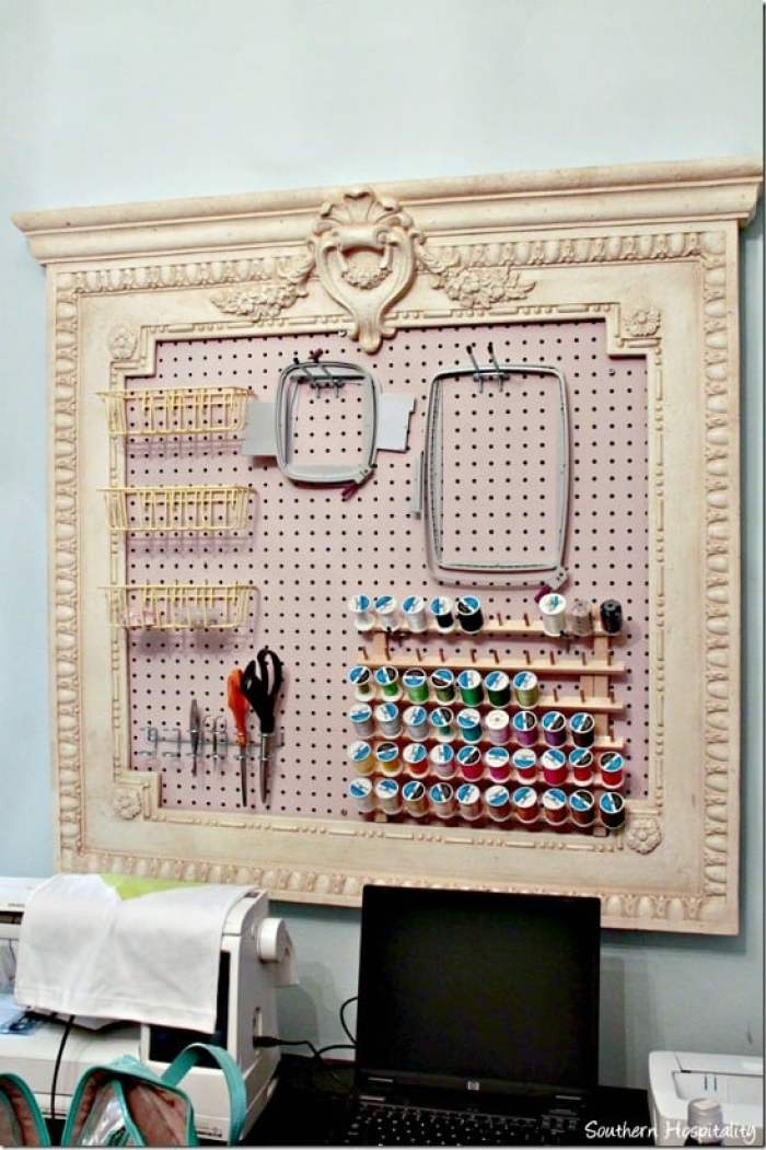 A DIY pegboard for a craft room showing organized storage. Craft room ideas, craft room ideas on a budget, hobby room idea, sewing room idea, craft area ideas,craft room inspiration, home office craft room ideas.