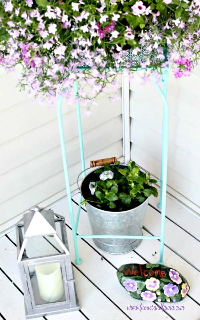 Turquoise planter with lilac coloured flowers. porch, small front porch ideas, porch ideas, front porch ideas, front porch, front porch decorating ideas