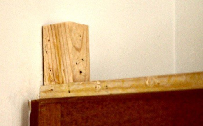 Corner brackets and framing for adding crown moulding to kitchen cabinets. A DIY kitchen remodel project.
