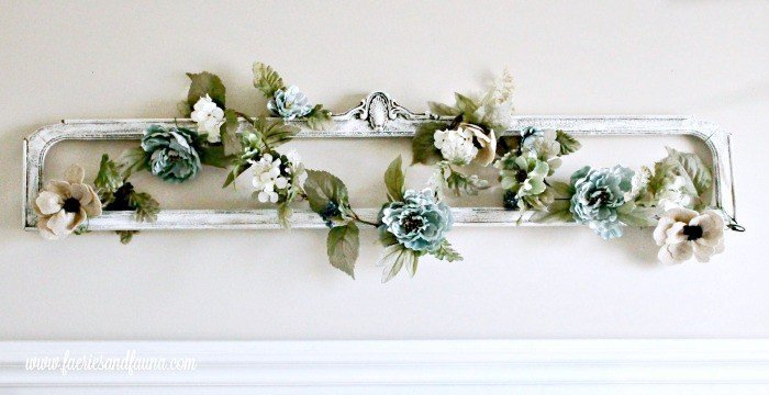 Refurbished antique wood frame with vines and flowers for above the bed.