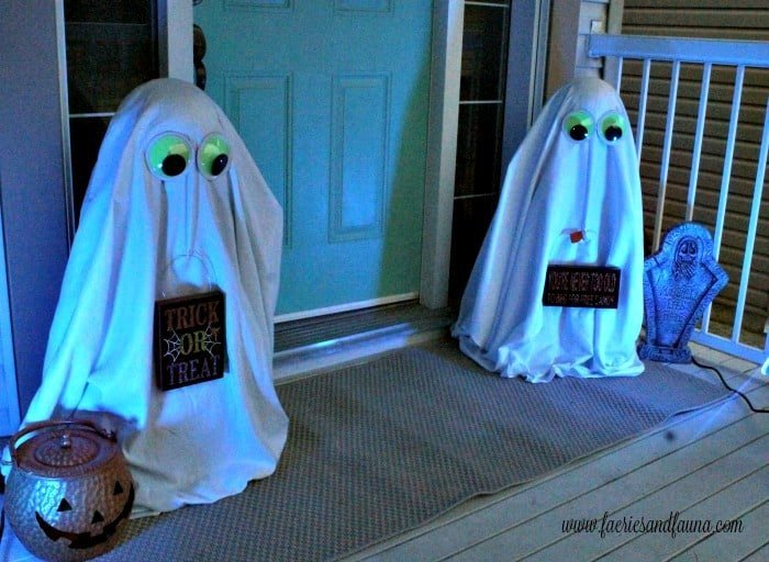 Hal.loween front porch with not scary DIY Halloween outdoor ornaments of ghosts.