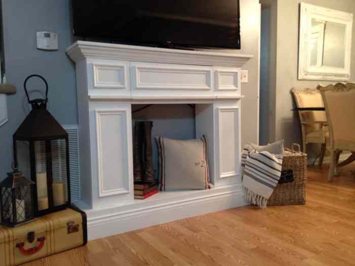 A DIY faux fireplace and mantel, that is perfect for fall or Christmas decorating.