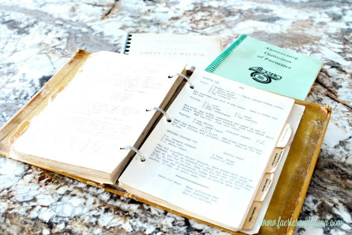 A stack of old vintage cookbooks showing the original flapper pie recipe. flapper pie, flapper pie recipe, vintage pie recipe, vintage recipes,