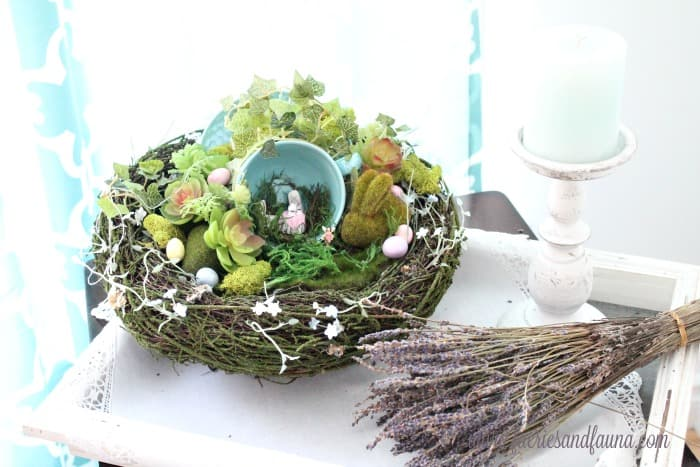 A diy Fairy garden idea for Easter with a few Easter eggs and an Easter bunny.