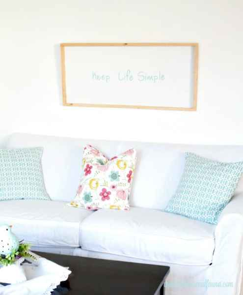 A Keep Life Simple DIY wood sign, hung above a casual sofa, this rustic sign is bright and cheerful for Spring decor. How to make a DIY sign for Summer decor tutorial collage. Keep life simple sign,  DIY signs,  DIY wood sign making,  DIY painted signs, DIY home decor signs, DIY summer decor
