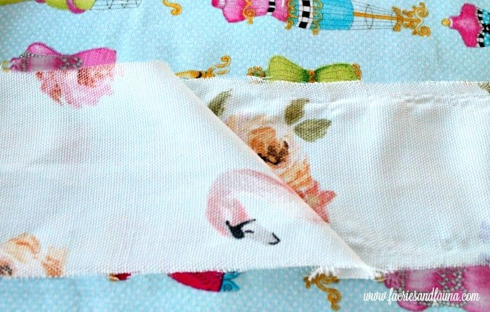 Fabric being sewn into one strip for DIY piping. Chair repair, furniture restoration, recover chairs DIY, how to reupholster a chair, reupholstery, chair reupholstery, furniture repair, recovering furniture, how to recover a chair.