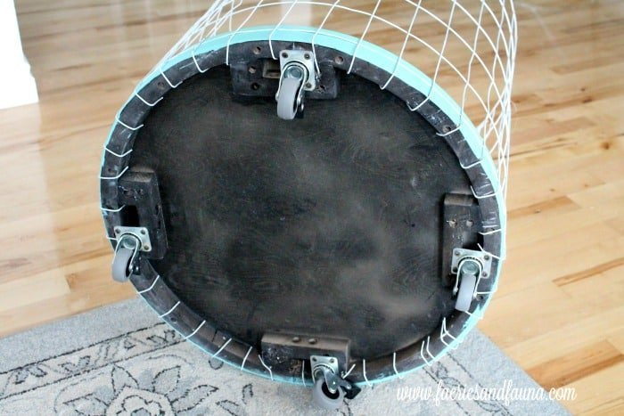 The underside of a Wire Laundry Hamper tutorial, showing how to attach the basket to the base.