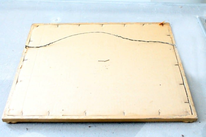 The back of an old frame prior to being made over