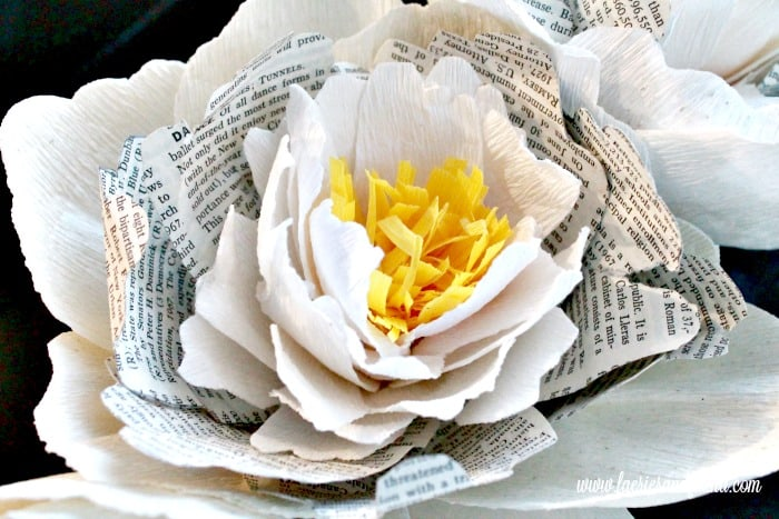 Crepe paper peony wreath tutorial or book pages closeup photo showing all the various layers of hand made paper petals formed together to make mightylinksfo