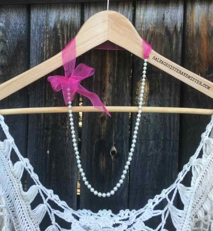 A pearl and ribbon necklace craft project.