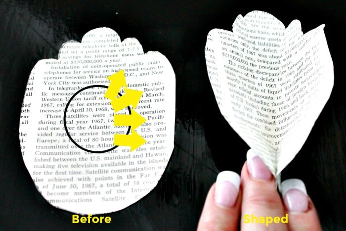 Book paging being formed into peony petals. Flower making, how to make paper flowers, flower making with crepe paper, minimalist wreath, elegant wreath, diy wedding decor, paper flowers wedding, book page crafts.