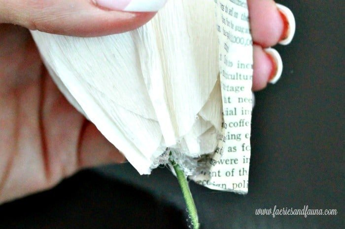 Illustrative photo showing the placement of the second layer of hand made paper petals for a peony flower craft. Flower making, how to make paper flowers, flower making with crepe paper, minimalist wreath, elegant wreath, diy wedding decor, paper flowers wedding, book page crafts.