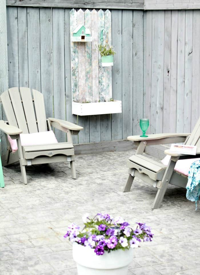 A Back Yard Deck With Pallet Wood Flower Pox Box