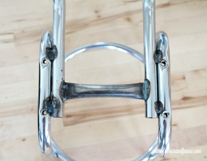 Welded metal on a vintage stool. How to fix a vintage stool, repairing a vintage stool, upcycled furniture, furniture for cheap, craft room makeover projects